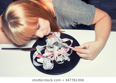 sad-looking-woman-on-diet-260nw-347761304