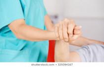 geriatric-nurse-holding-hands-senior-260nw-329394167
