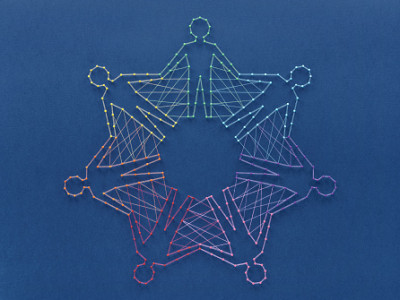 Unity without uniformity and diversity without fragmentation. Network of pins and threads in the shape of people holding hands symbolising community around the world.